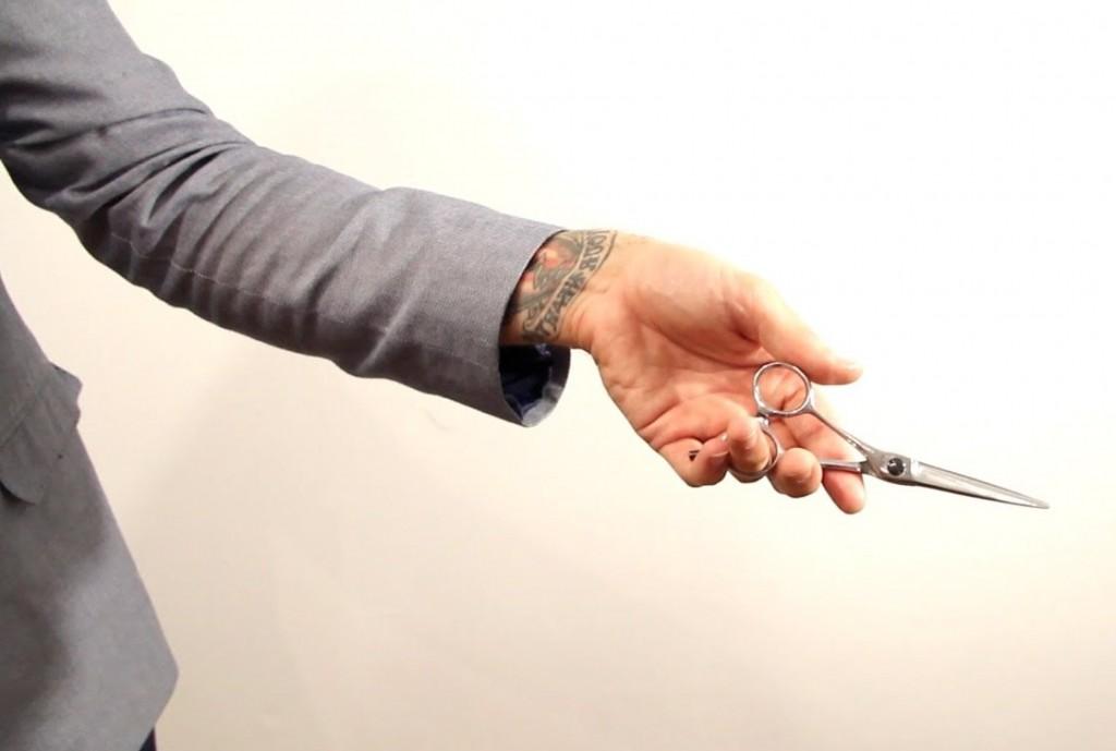 hand holding scissor